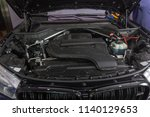a car engine compartment being ... | Shutterstock . vector #1140129653
