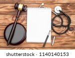 Blank Notepad With Gavel And...