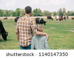 back view of father and son... | Shutterstock . vector #1140147350
