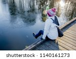 young girl with hat and winter... | Shutterstock . vector #1140161273