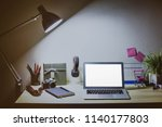work place at home laptop and... | Shutterstock . vector #1140177803