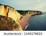 etretat chalk cliffs at sunset. ... | Shutterstock . vector #1140178823