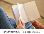 man reading interesting book at ... | Shutterstock . vector #1140180113
