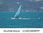 windsurfing at lake lucerne ... | Shutterstock . vector #1140180899