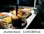 fresh delicious hamburger and... | Shutterstock . vector #1140188516