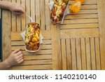 hands of a teenager with a fork ...   Shutterstock . vector #1140210140
