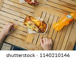 hands of a teenager with a fork ... | Shutterstock . vector #1140210146
