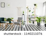 wooden table between armchairs... | Shutterstock . vector #1140211076