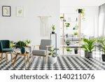 wooden table between armchairs...   Shutterstock . vector #1140211076