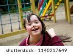 little girl having fun on the... | Shutterstock . vector #1140217649
