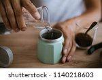 pouring water in a moka pot   Shutterstock . vector #1140218603