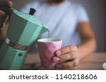 pouring coffee in a coffee cup   Shutterstock . vector #1140218606