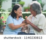 smiling happy asian elderly... | Shutterstock . vector #1140230813