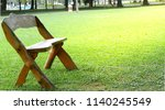 lonely bench bench in park. | Shutterstock . vector #1140245549