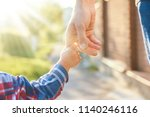 the parent holding the child's... | Shutterstock . vector #1140246116