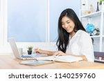 student hand holding pen... | Shutterstock . vector #1140259760