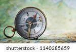 magnetic compass on world map... | Shutterstock . vector #1140285659