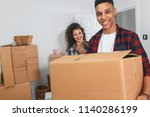 happy young couple moving into... | Shutterstock . vector #1140286199