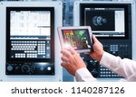 engineer hand using tablet with ... | Shutterstock . vector #1140287126