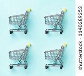 shopping cart on blue... | Shutterstock . vector #1140289253