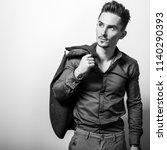 handsome young elegant man.... | Shutterstock . vector #1140290393