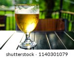 refreshing apple cider with ice ...   Shutterstock . vector #1140301079