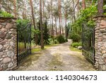 iron entrance gate and stony... | Shutterstock . vector #1140304673