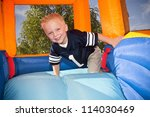 Boy Playing On And Inflatable...