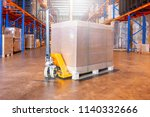 manual forklift with shipment... | Shutterstock . vector #1140332666