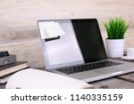 stylish workspace with computer ...   Shutterstock . vector #1140335159