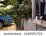 blue car and green fern tree ... | Shutterstock . vector #1140351710