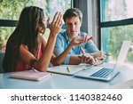 couple in love sitting at... | Shutterstock . vector #1140382460