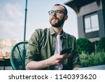 pondering bearded young man... | Shutterstock . vector #1140393620