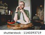 pondering bearded student... | Shutterstock . vector #1140393719