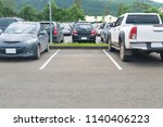 Car Parked In Asphalt Parking...