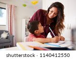 mother helping son with... | Shutterstock . vector #1140412550