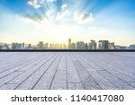 empty square with city skyline... | Shutterstock . vector #1140417080