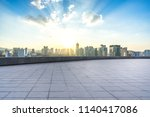 empty square with city skyline... | Shutterstock . vector #1140417086