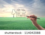 hand drawing an house on a... | Shutterstock . vector #114042088