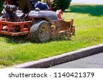process of lawn mowing  concept ... | Shutterstock . vector #1140421379