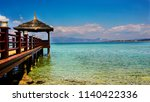 scenic seascape and wooden pier ... | Shutterstock . vector #1140422336