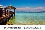 scenic seascape and wooden pier ... | Shutterstock . vector #1140422336