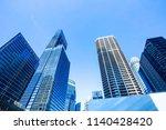 skyscrapers in financial... | Shutterstock . vector #1140428420
