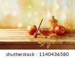 honey and apples on wooden...   Shutterstock . vector #1140436580