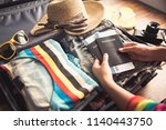 people holding passports  map... | Shutterstock . vector #1140443750