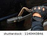 theft hands in black gloves ... | Shutterstock . vector #1140443846