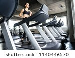 cute young woman exercising on  ... | Shutterstock . vector #1140446570