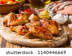 grilled chicken wings with... | Shutterstock . vector #1140446669