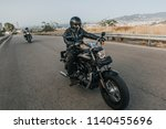 man in black clothes riding a... | Shutterstock . vector #1140455696