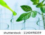 pipette over test tube dropping ... | Shutterstock . vector #1140498359